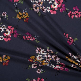 Viscose crepe fabric - pastel flowers on NAVY BLUE
